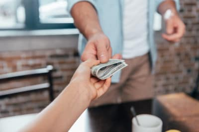 A person handing over money.