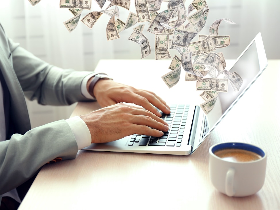 Money coming out of a computer.